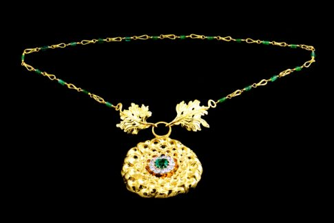 22K GOLD CHASING AND REPOUSSÉ CRYSANTHEUM FLOWER AND LEAVE CLASP ON HANDMADE 22K GOLD AND EMERALD NECKLACE. DIAMOND AND EMERALD RING TOP FROM CLIENT.